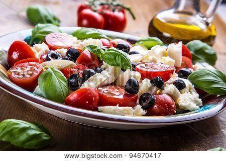 Caprese. Caprese salad. Italian salad. Mediterranean salad. Italian cuisine. Mediterranean cuisine.