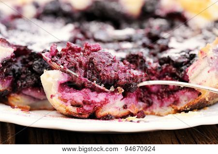 French Pie Clafoutis With Cherry And Spoon In White Plate