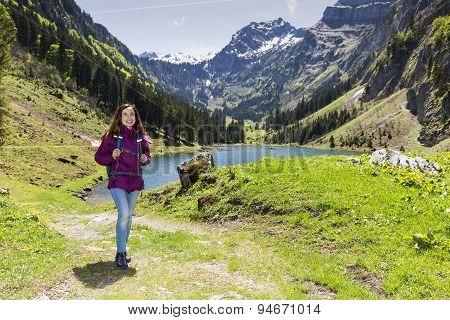 Woman Hiking In Beautiful Landscape