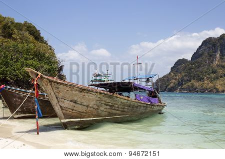Long Boat And Tropical Beach