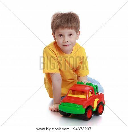 little boy in a yellow t-shirt