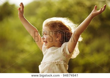 Happy And Cheerful Little Girl