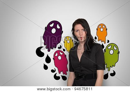 Young woman on a white background with colorful cartoon ghosts