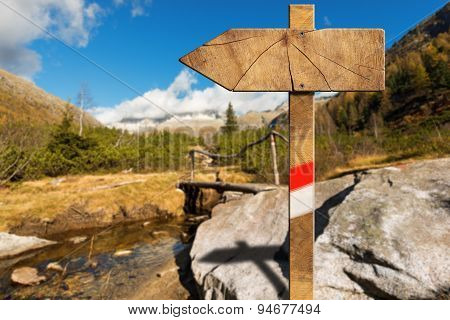 Wooden Directional Trail Sign In Mountain