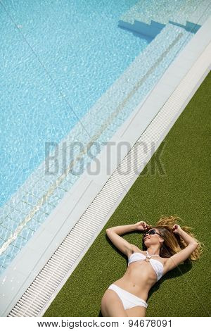 Young Woman By The Pool