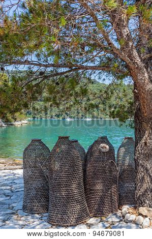 Sea fishing traps under the tree