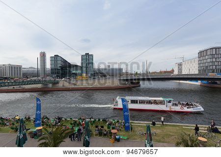 The central station of Berlin (Hauptbahnhof), river spree and boat