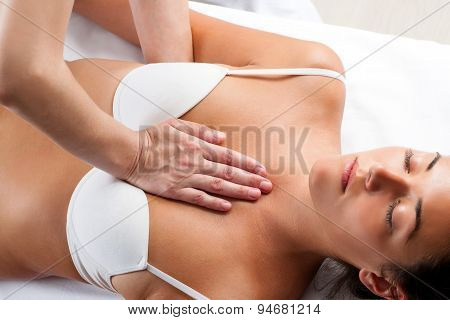 Therapist Pressing On Woman's Chest.