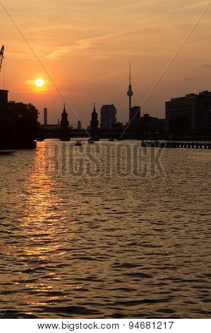 berlin skyline sunset over spree - oberbaum bridge and tv tower