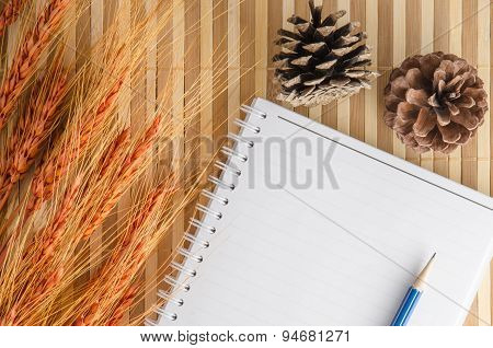 Blank Notepad Notebook With Pencil On Brown Bamboo Background