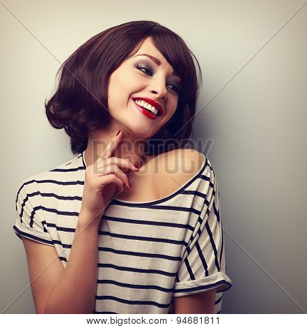 Happy Laughing Young Short Hairstyle Woman In Fashion Blouse Touching Neck