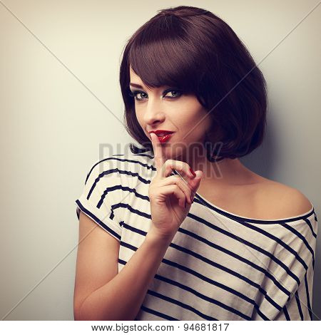 Beautiful Makeup Young Woman Showing Silence Sign. Short Hair Style. Vintage Portrait