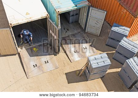 Unloading Shipping Containers