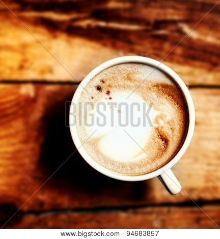 Coffee Cup On A Wooden Table, Top View. Dark Background.
