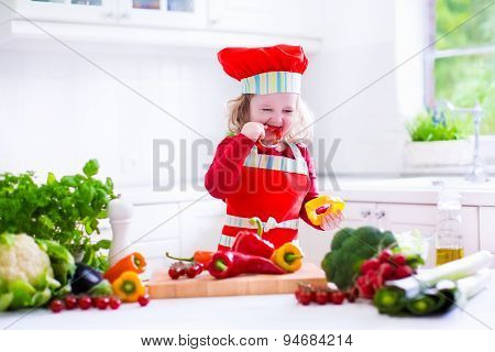 Little Girl In Chef Hat Preparing Lunch