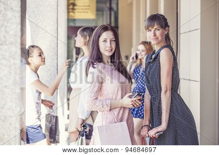 Girls girlfriends with shopping on the porch shopping beautiful