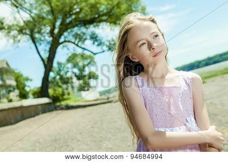 Adorable little girl on beach vacation