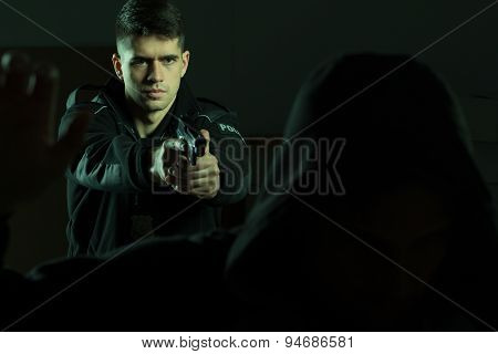 Cop Pointing Pistol At Criminal