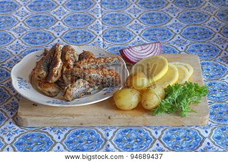 Plate Of Fried Baltic Herring, Potato, Lemon, Red Onion And Parsley