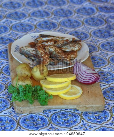 Plate Of Fried Baltic Herring, Potato, Red Onion And Parsley
