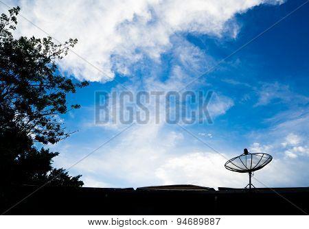 Silhouette Of Satellite Dish On Blue Sky