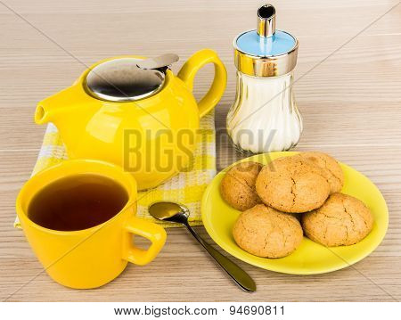 Yellow Tea Cup With Tea And Cookies