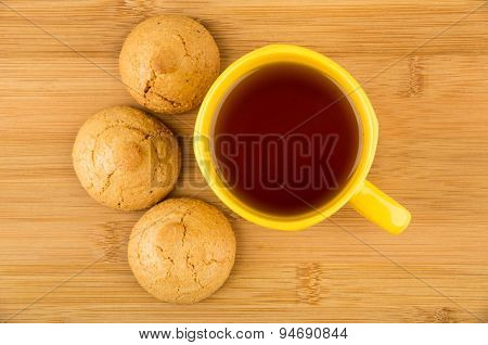 Nut-almond Biscuits In Yellow Saucer And Hot Tea