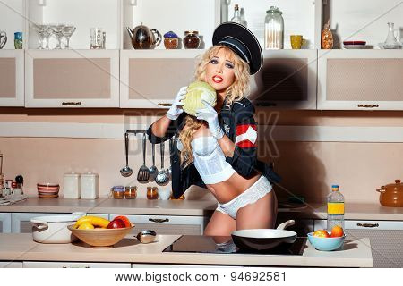 Girl In The Kitchen With Cabbage Her Hands.