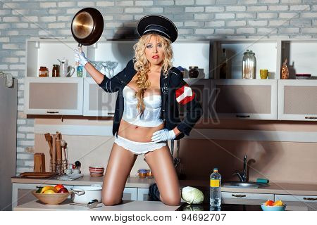 Brutal Girl Standing On A Table In The Kitchen.