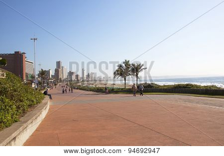 People Walking Beach Front Promenade In Durban South Africa