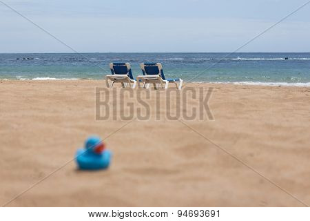 beach, sand and duckling toy - vacation background