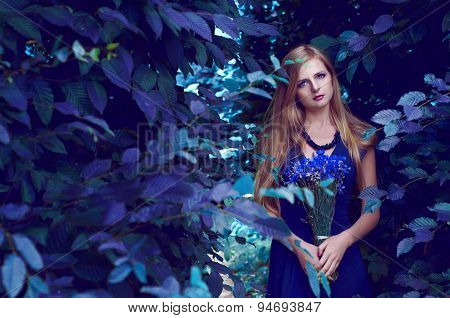 Beautiful blonde woman with long hair in the labyrinth
