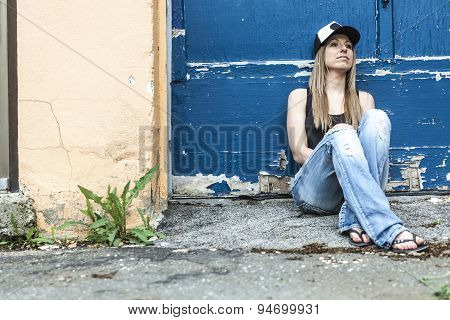 Portrait of young beautiful skater girl posing