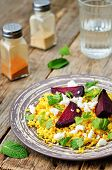 stock photo of millet  - spiced millet porridge with beetroot coriander mint and feta - JPG