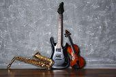 pic of saxophones  - Electric guitar - JPG