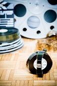 stock photo of mm  - 35 mm cinema movie filmstrip with picture start frame and other movie objects background vertical frame - JPG