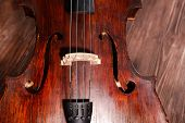 pic of cello  - Vintage cello on wooden background - JPG