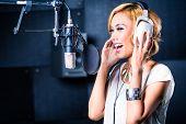 picture of recording studio  - Asian professional musician recording new song or album CD in studio - JPG
