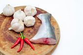 stock photo of pangasius  - Pangasius or Vietnamese catfish in the kitchen in a white background - JPG