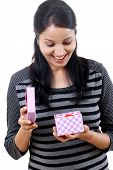 pic of salwar-kameez  - Happy woman opening a gift box against white - JPG