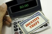 stock photo of theft  - Identity theft of Social Securtity card with an empty bank account - JPG