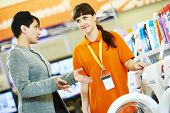 image of blender  - Young woman choosing electric kitchen blender in home appliance shopping mall supermarket - JPG