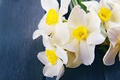 stock photo of jonquils  - Beautiful bouquet of daffodils on wooden background - JPG
