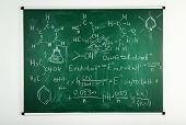 stock photo of formulas  - Molecule models and formulas on blackboard background - JPG