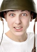 picture of conscript  - Teenager in Military Helmet Isolated on the White Background - JPG