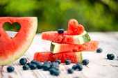 image of watermelon slices  - watermelon slices with love decorate on a wooden table - JPG