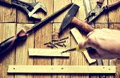 pic of pliers  - Hammer flat file pliers screwdriver monkey wrench screws board and blade on natural wooden background - JPG