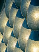 picture of stone sculpture  - Steel sculpture represents Water Drops on Stone Wall - JPG