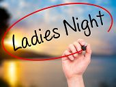pic of ladies night  - Man Hand writing Ladies Night with black marker on visual screen - JPG