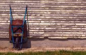 foto of wheelbarrow  - Old rusty wheelbarrow  - JPG